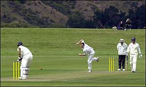 David Sewell bowling for NZ.